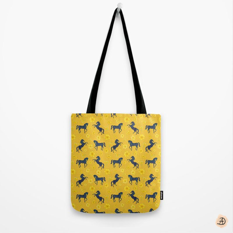 A summer yellow tote bag with a pattern of blue rearing horses, for girls who love anything equestrian.