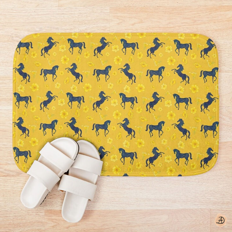 A yellow bath mat with printed blue rearing horses, a bathroom design for women who love horses.