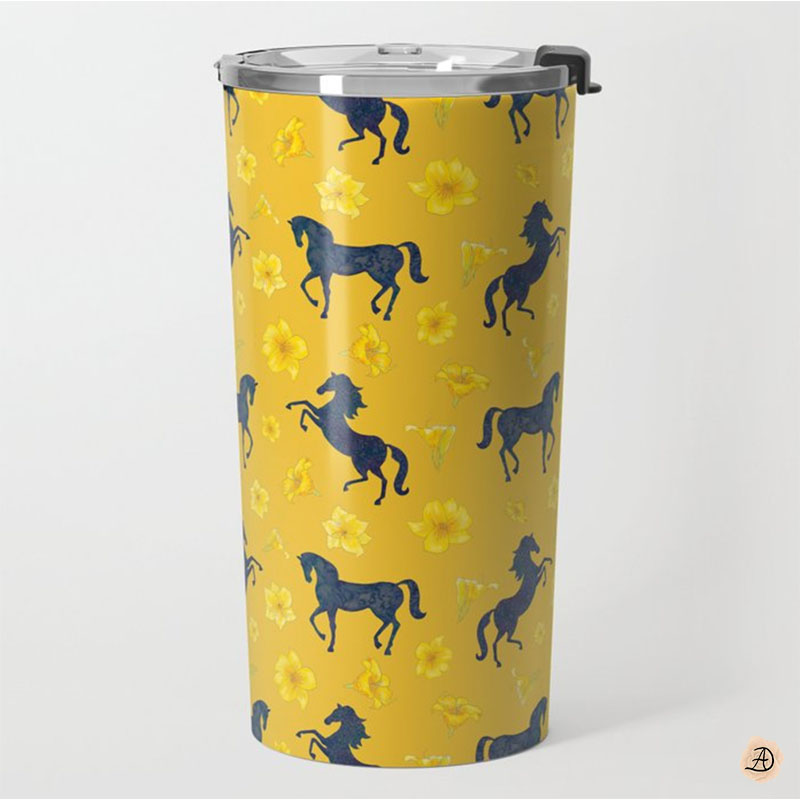 A metal travel mug printed with a blue and yellow horse pattern for women who love horses.
