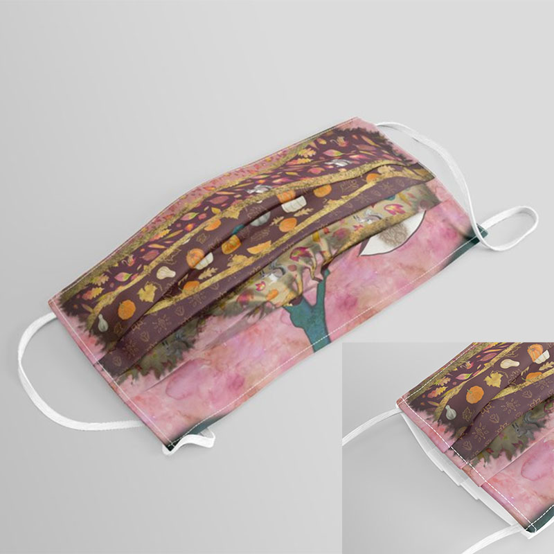 Decorative art print with bohemian tree with fall leaves and pumpkins printed on face mask