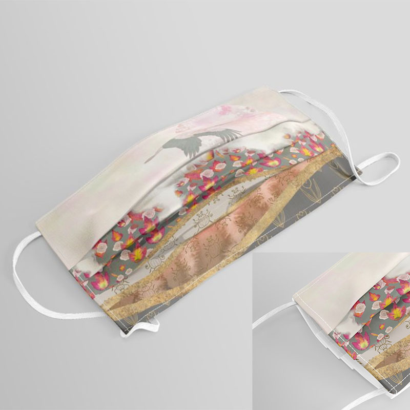 Cloth face mask with autumn landscape print featuring a stork flying above fall foliage