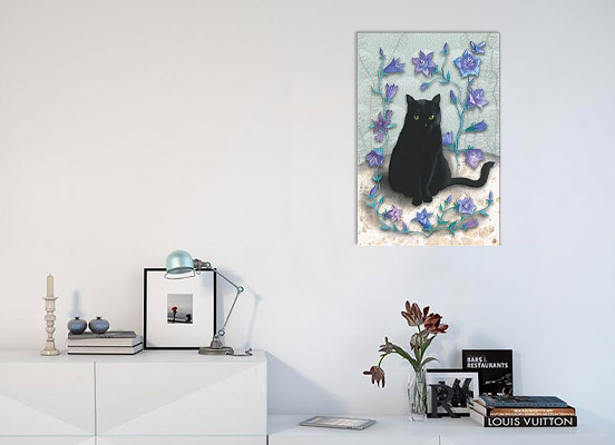 Art print of a black cat hanging on a wall