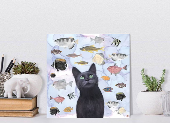 A picture of an art print of a black cat watching a fish tank
