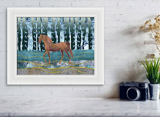 Framed wall art depicting a horse walking in the forest