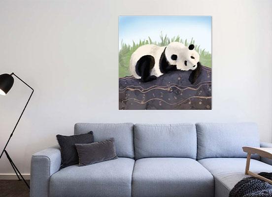 Canvas art print on a wall, depicting a panda bear