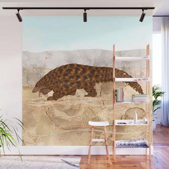 A wall mural depicting a pangolin painting