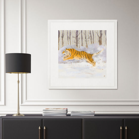Framed Art print with a tiger running in the snow