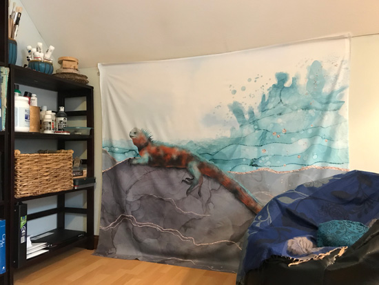 Society6 Wall tapestry by Andreea Dumez, depicting a marine iguana on the seashore