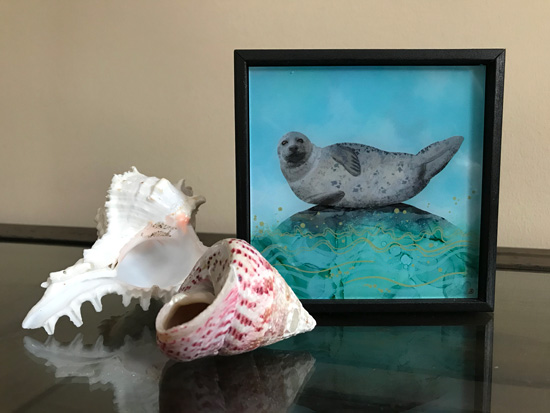 Aqua mini art print depicting a sea life scene with a cute seal sitting on a rock