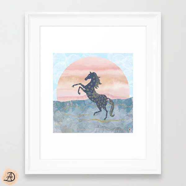 White framed wall art depicting an illustration of a rearing horse