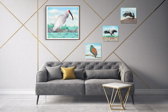 Above the couch modern gallery wall with framed bird prints