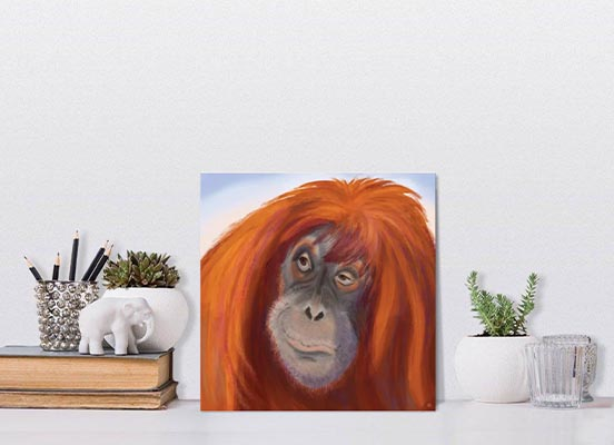 Small art print with a red haired Orangutan portrait